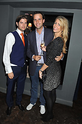 Left to right, JACK FREUD, CHARLIE GILKES and ANNEKE VON TROTHA TAYLOR at the launch party for Barberella, 428 Fulham Road, London SW6 on 17th October 2012.