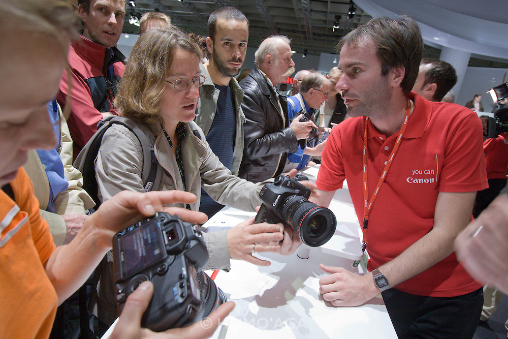Photokina 2008, World's bigest bi-annual photo fair. Visitors trying out the new Canon EOS 5D Mark II.