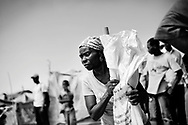 Haiti Earthquake, Port au Prince.<br /> Relief ERU making distribution in Camp Jacobad, where they give out shelter kits (different tools and robe), timber and tarpaulins.