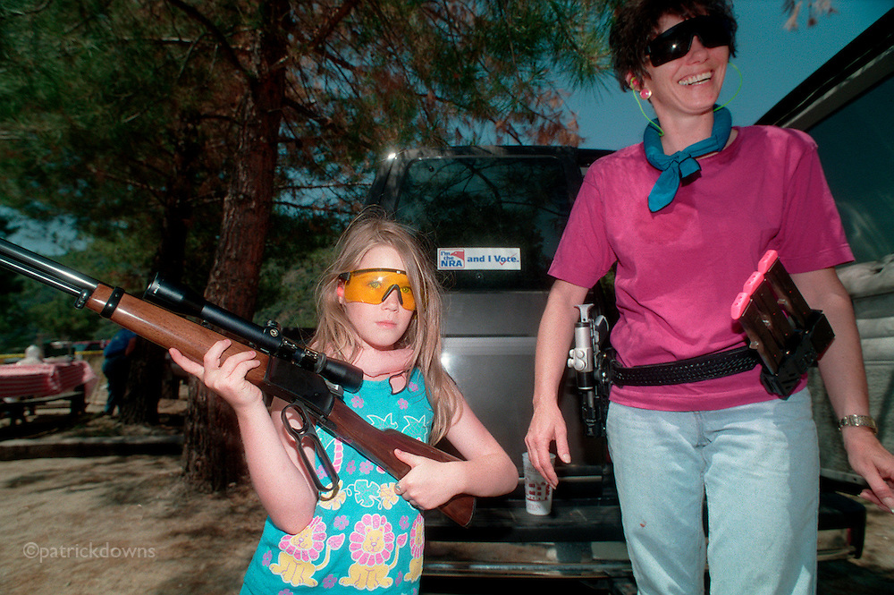 Colleen Janssen and daughter Stephanie, in the mountains above Azusa/LA. Colleen was shooting her custom $3000 competition pistol, and her daughter shows off her Browning .22 caliber rifle, which she shoots very well and safely, according to Mom.