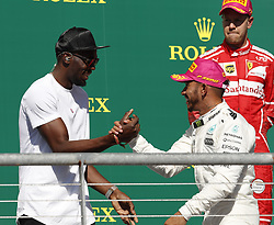 October 22, 2017 - Austin, United States of America - Motorsports: FIA Formula One World Championship 2017, Grand Prix of United States, ..Usain Bolt, #44 Lewis Hamilton (GBR, Mercedes AMG Petronas F1 Team) (Credit Image: © Hoch Zwei via ZUMA Wire)