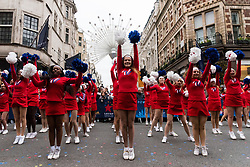 © Licensed to London News Pictures. 01/01/2018. Cheerleaders perform in London's New Year's Day Parade on 1 January 2017 in central London. The event is one of the world's great street spectaculars with up to 10,000 performers from around the world and hosts marching bands, cheerleaders, leading companies, unions and local boroughs celebrating the arrival of 2017.London, UK. Photo credit: Ray Tang/LNP