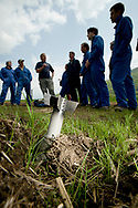 Centurion instructor Paul leads a discussion on the dangers of unexploded ordinance, in this case a mortar round, during the 5-day HEFAT course in Virginia.  Most of the participants in the course are journalists heading to war zones around the globe. Mortar training for the Hostile Environments and Emeregency First Aid Training course for journalists deploying to war zones in Strausburg, VA. (Not Released)