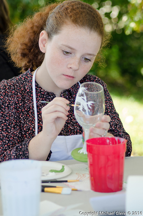 15 Oct. 2016 Forked River USA / DanaRose paints the branches on a wine glass during the wine glass painting class as St Pius X celebrates it's 10th year in their new church with a festival open to all  /  Michael Glenn  / Glenn Images