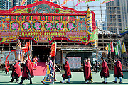 At a buddhist procession in front of a bamboo theatre temporarily built in Ap Lei Chau, Hong Kong, for the festival of the god Hung Shing,  held on the 13th day of the 2nd month in Chinese calendar.<br /> <br /> In the Chinese opera tradition, the actors are playing for the gods not to entertain the people.