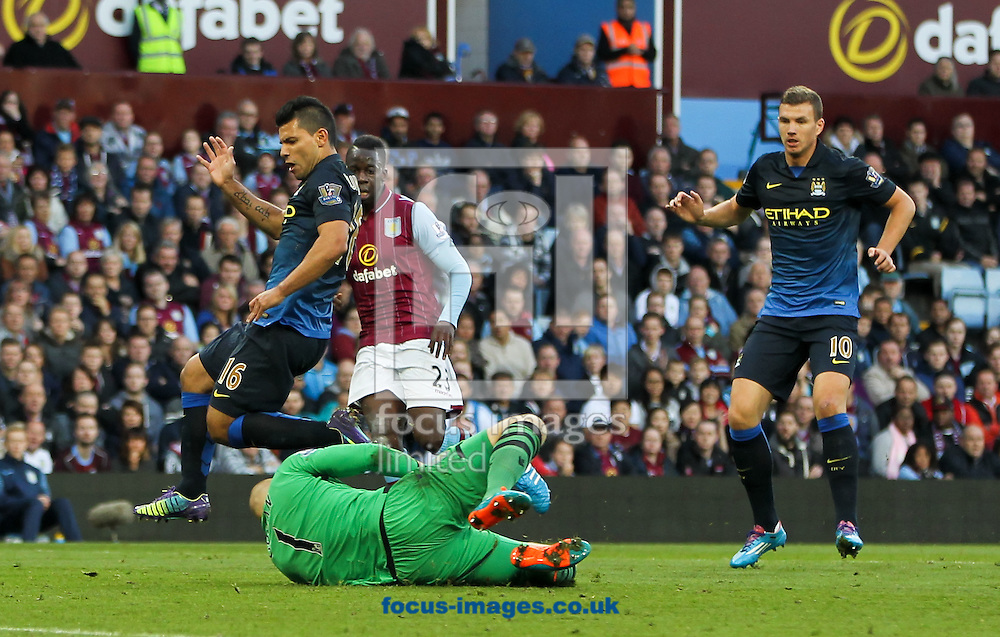 Brad Guzan (bottom centre) of Aston Villa beats Sergio Ag&uuml;ero (left) of Manchester City to the ball during the Barclays Premier League match at Villa Park, Birmingham<br /> Picture by Tom Smith/Focus Images Ltd 07545141164<br /> 04/10/2014