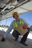 Maintenance worker checking solar panel in Los Angeles California