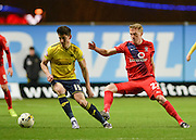 Oxford United Midfielder Callum O-Dowda and York City defender Luke Hendrie during the Sky Bet League 2 match between Oxford United and York City at the Kassam Stadium, Oxford, England on 1 March 2016. Photo by Adam Rivers.
