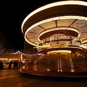 A carousel spins at the Avignon Christmas market
