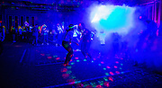 Students and their sibs dance in the Baker Ballroom during the Glo Party on Sibs Weekend.