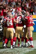 San Francisco 49ers wide receiver Kendrick Bourne (84) gets swarmed by teammates in the end zone after Bourne catches a first quarter touchdown pass good for a 14-0 49ers lead during the NFL week 4 regular season football game against the Los Angeles Chargers on Sunday, Sept. 30, 2018 in Carson, Calif. The Chargers won the game 29-27. (©Paul Anthony Spinelli)