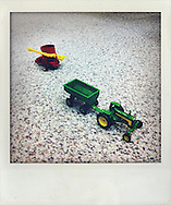 A toy tractor on the floor at a campaign stop by Republican presidential hopeful TIm Pawlenty on Wednesday, July 20, 2011 in West Des Moines, IA.