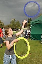 Girl juggling with hoops at a Parklife summer activities event,