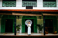 A staff in what ao dai at Le Longanier restaurant in Cai Be, in the Mekong Delta of southern Vietnam.