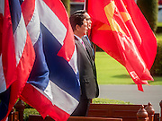 23 JULY 2015 - BANGKOK, THAILAND:  NGUYEN TAN DUNG (left), Prime Minister of Vietnam,  and PRAYUTH CHAN-O-CHA, Prime Minister of Thailand, (right) stand amidst fluttering Thai and Vietnamese flags on the reviewing stand at Government House in Bangkok. The Vietnamese Prime Minister and his wife came to Bangkok for the 3rd Thailand - Vietnam Joint Cabinet Retreat. The Thai and Vietnamese Prime Minister discussed issues of mutual interest.     PHOTO BY JACK KURTZ