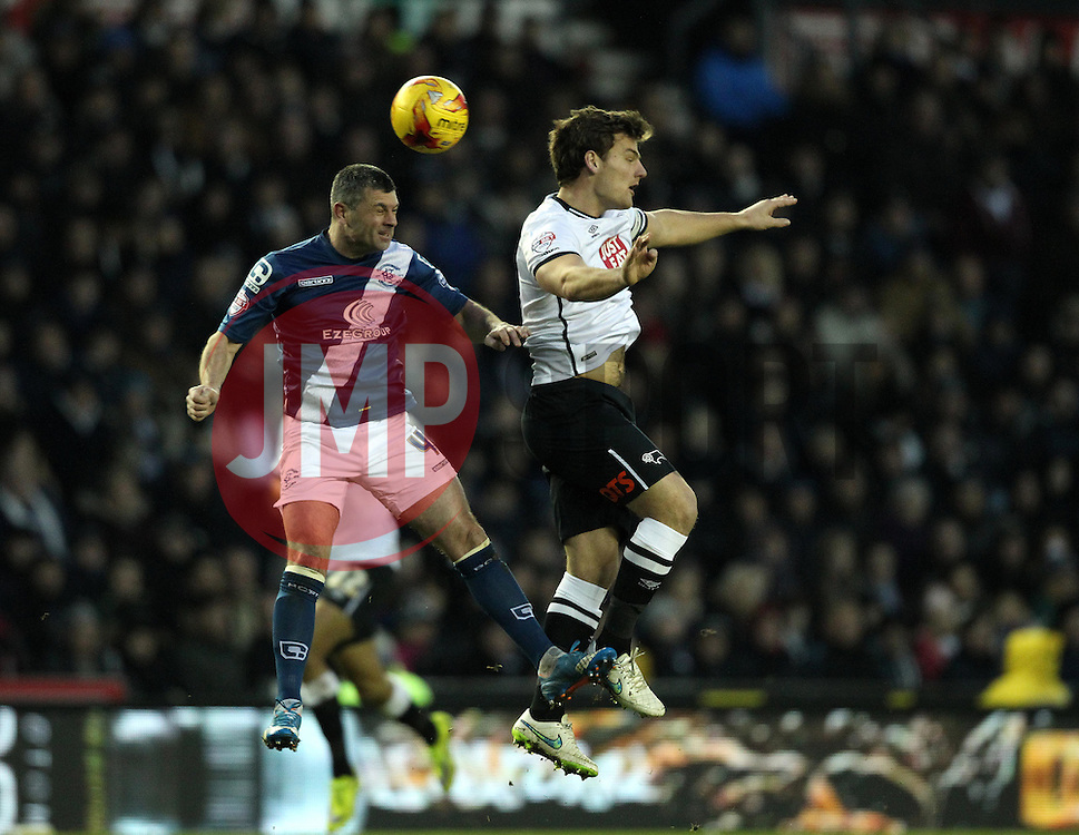 Paul Robinson of Birmingham City wins a header against Chris Martin of Derby County - Mandatory byline: Robbie Stephenson/JMP - 16/01/2016 - FOOTBALL - iPro Stadium - Derby, England - Derby County v Birmingham City - Sky Bet Championship