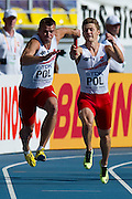 (R) Robert Kubaczyk and (L) Grzegorz Zimniewicz both from Poland compete in men's relay 4x100 meters qualification during the 14th IAAF World Athletics Championships at the Luzhniki stadium in Moscow on August 18, 2013.<br /> <br /> Russian Federation, Moscow, August 18, 2013<br /> <br /> Picture also available in RAW (NEF) or TIFF format on special request.<br /> <br /> For editorial use only. Any commercial or promotional use requires permission.<br /> <br /> Mandatory credit:<br /> Photo by &copy; Adam Nurkiewicz / Mediasport
