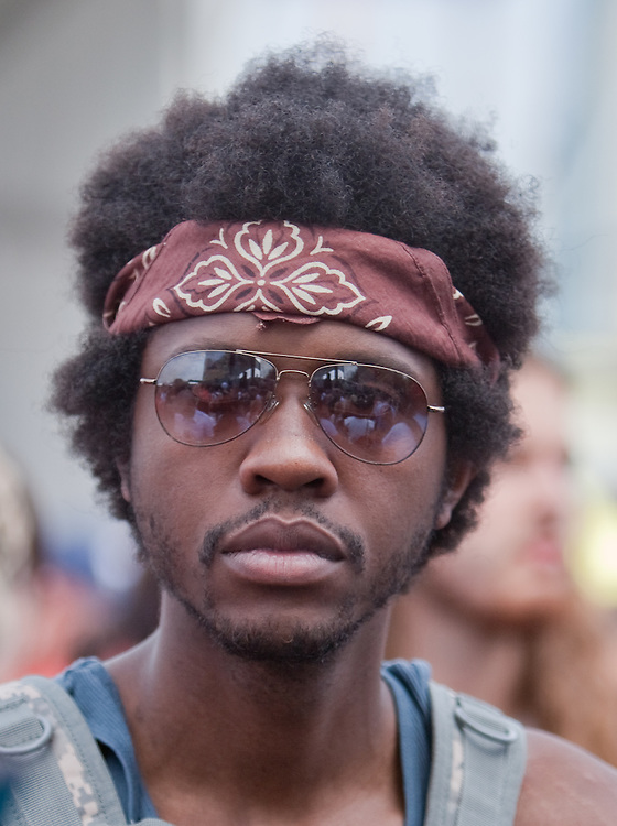 ACL Festival attendee sports a retro afro and headband.