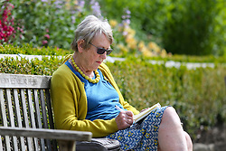 © Licensed to London News Pictures. 18/07/2016. Batley, UK. A woman reads a book in the high temperatures and sunny weather at Golden Achre park in Leeds West Yorkshire.The UK is set to experience a mini heatwave over the next week with temperatures hitting the highest of the year so far.  Photo credit : Ian Hinchliffe/LNP