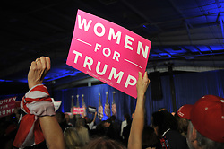 Barbara Robinson, of Montgomery, NJ raises her fist as she attends a rally with Melanie Trump in Chester County, on Thursday.
