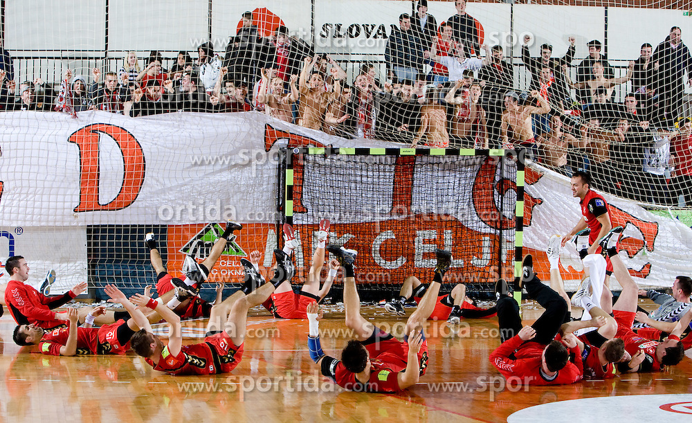 Players of Slovan and Red Tigers, fans of Slovan celebrate during the 1/ 8 Men's European Handball Challenge Cup match between RD Slovan, Slovenia and Ystads IF, Sweden, on February 21, 2009 in Arena Kodeljevo, Ljubljana, Slovenia. Slovan defeated Ystads 37-27 and qualified to quarterfinals. (Photo by Vid Ponikvar / Sportida)