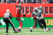 Carolina Panthers Defensive Linesman Vernon Butler (92) strips the ball off Tampa Bay Buccaneers Quarterback Jameis Winston (3) during the International Series match between Tampa Bay Buccaneers and Carolina Panthers at Tottenham Hotspur Stadium, London, United Kingdom on 13 October 2019.