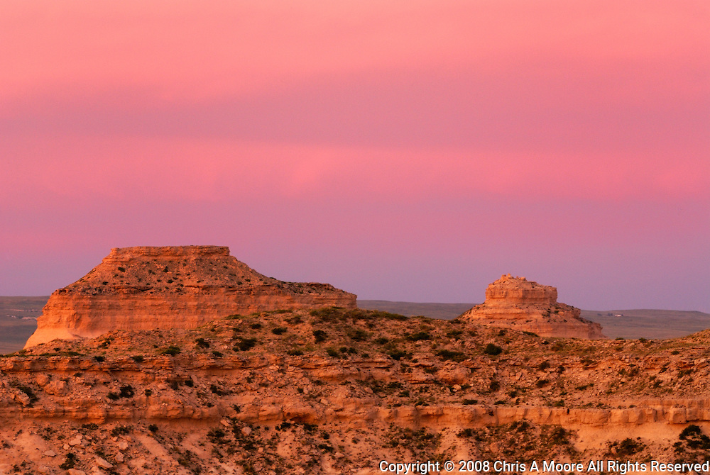 Pawnee Buttes glow red at sunset in northeastern Colorado.  They are the namesake of the National Grassland that surround them.