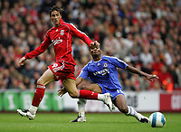 Photo: Paul Thomas.<br /> Liverpool v Chelsea. The FA Barclays Premiership. 19/08/2007.<br /> <br /> Goal scorer Fernando Torres (L) of Liverpool battles Florence Malouda.