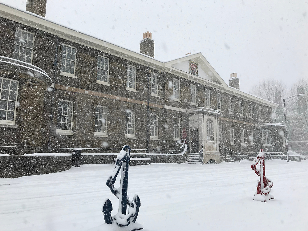 © Licensed to London News Pictures. 27/02/2018. Chatham, UK. Snow hits Chatham Historic Dockyard. The dockyard is used for many filming locations including Call the Midwife. Photo credit: Graham Long/LNP