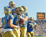 Freshman tight end Cory Harkey (87) is embraced by teammates redshirt sophomore center Jake Dean (57), redshirt senior guard/center Micah Reed (58), and redshirt junior quarterback Kevin Craft (3) after catching a 7-yard touchdown pass from Craft with ten seconds remaining in the fourth quarter of UCLAs 23-20 victory over Stanford at the Rose Bowl in Pasadena, Calif., on Saturday, Oct. 18, 2008.  Harkeys go-ahead touchdown put UCLA ahead for the final time and sealed the win for the Bruins.