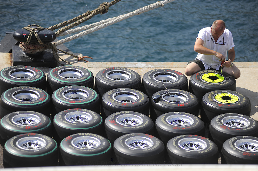 Final preparations are being made in Monte Carlo ahead of this weekends Monaco Grand Prix. Pictured a Brawn GP Mechanic prepares tyres before the Grand Prix.