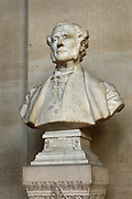 Bust of the architect Joseph-Louis Duc, 1802-79, by Henri Chapu, 1833-91, 1891, in the Vestibule de Harlay, inaugurated 1875, the main entrance to the Law Courts, named after president Achille de Harlay, first president of the Paris parliament 1582-1611, in the Palais de Justice or Paris Law Courts, on the Ile de la Cite, Paris, France. The hall was designed by Joseph-Louis Duc and is 55m long and 24m wide. It contains Egyptian elements inspired by the temple at Denderah. The former royal palace was originally a medieval building, reworked and rebuilt several times, with a major reconstruction 1857-68 by architects Joseph-Louis Duc and Honore Daumet under Haussmann. The complex includes the Palais de Justice, the Sainte-Chapelle and the Conciergerie. Picture by Manuel Cohen