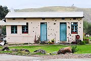 Israel, Jordan Valley, The original site of Kibbutz Gesher (bridge) named for the bridge over the Jordan river that connected the rail network in Palestine to the main Turkish Track. Bullet holes can be seen in the building