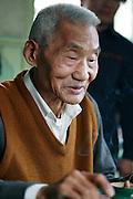 Old Man in Jaingnan Ancient River Town, Shanghai - China
