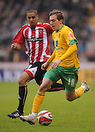 Sheffield - Saturday January 9th, 2009: Kyle Naughton of Sheffield United and Arturo Lupoli of Norwich City during the Coca Cola Championship match at Bramall Lane, Sheffield. (Pic by Alex Broadway/Focus Images)