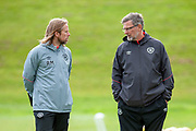 Heart of Midlothian manager Craig Levein (dark jacket) and Austin Macphee (left) during training at the Oriam Sports Performance Centre, Edinburgh on 13 September 2018, ahead of the away match against Motherwell.