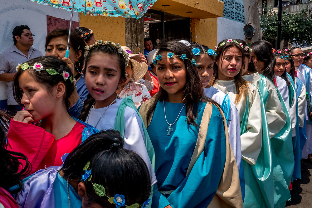 Young women in full costume wait in the streets as the procession is halted in the winding streets of Iztapalapa. An estimated 10 000 actors and acresses will participate in the event.