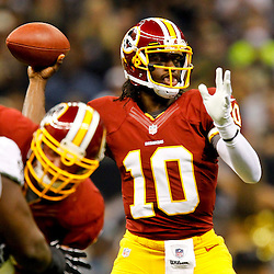September 9, 2012; New Orleans, LA, USA; Washington Redskins quarterback Robert Griffin III (10) throws against the New Orleans Saints during the first quarter of a game at the Mercedes-Benz Superdome. Mandatory Credit: Derick E. Hingle-US PRESSWIRE
