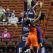 UNCASVILLE, CONNECTICUT- MAY 26:  Chiney Ogwumike #13 of the Connecticut Sun fouls her sister Nneka Ogwumike #30 of the Los Angeles Sparks during the Los Angeles Sparks Vs Connecticut Sun, WNBA regular season game at Mohegan Sun Arena on May 26, 2016 in Uncasville, Connecticut. (Photo by Tim Clayton/Corbis via Getty Images)