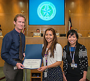 Roy de la Garza recognizes Nancy Casarrubias during the Houston ISD Board of Trustees meeting, May 14, 2015.