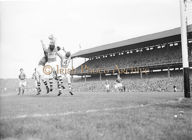 Three players jump high to catch the ball during the All Ireland Senior Football Championship Final, Armagh v Kerry in Croke Park on 27th September 1953, Kerry 0-13, Armagh 1-06.