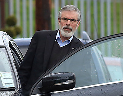 © London News Pictures. 21/03/2017. Derry, UK. Sinn Fein President Gerry Adams leaves the home of Martin McGuinness in the Bogside area of Derry, Northern Ireland, 21 March 2017. Sinn Fein's Martin McGuinness, Northern Ireland's former deputy first minister died aged 66 early this morning. Photo credit: LNP