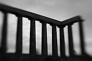 Silhouette of the National Monument atop Calton Hill in Edinburgh, Scotland.