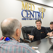 OCTOBER 6, 2017--PONCE, PUERTO RICO ---<br /> Allan Cintron Salichs, left, Executive Director of Med Centro in Ponce, listens to Direct Relief's Damon Taugher and Gordon Willcock.<br /> (Photo by Angel Valentin/Freelance)