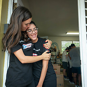 JULY 20, 2018---HATO REY, PUERTO RICO----<br /> Erin Schrode hugs volunteer Camille Mercado Rivera, 19,  at the headquarters of Chefs for Puerto Rico as food is prepared to be delivered during the day as part of the World Central Kitchen initiative in Puerto Rico which came to prominence following the aftermath of the devastation left by Hurricane Maria in Puerto Rico. <br /> (Photo by Angel Valentin/Freelance)