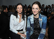 Liberty Ross, left, and Sofia Sanchez Barrenechea pose for a photograph before the Altuzarra Fall 2014 collection is presented during Fashion Week in New York, Saturday, Feb. 8, 2014. (AP Photo/Diane Bondareff)