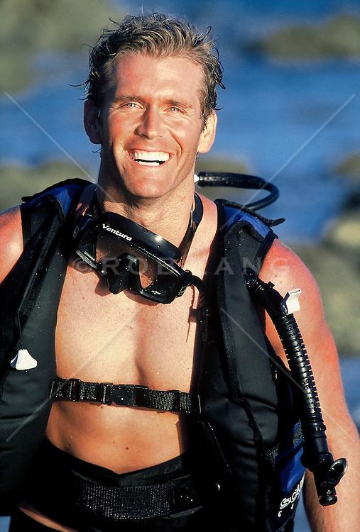 Man wearing scuba gear at the ocean