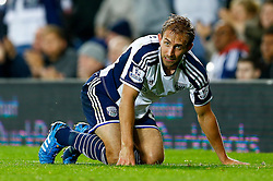 Craig Dawson of West Brom is left on the floor after a bad challenge from Junior Brown of Oxford United leading to a second yellow card and a sending off in extra time - Photo mandatory by-line: Rogan Thomson/JMP - 07966 386802 - 26/08/2014 - SPORT - FOOTBALL - The Hawthorns, West Bromwich - West Bromwich Albion v Oxford United - Capital One Cup Round 2.
