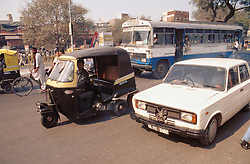 Car; bike; bus; and auto rickshaw stuck in traffic jam in Delhi; India,