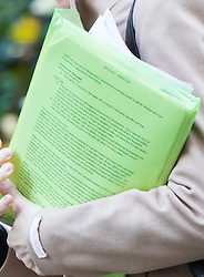 London, December 01 2017. Careless Brexit team members walk up downing Street with sensitive documents on display relating to Francovitch damages, the right to which will no longer exist under UK domestic law after Brexit. © Paul Davey